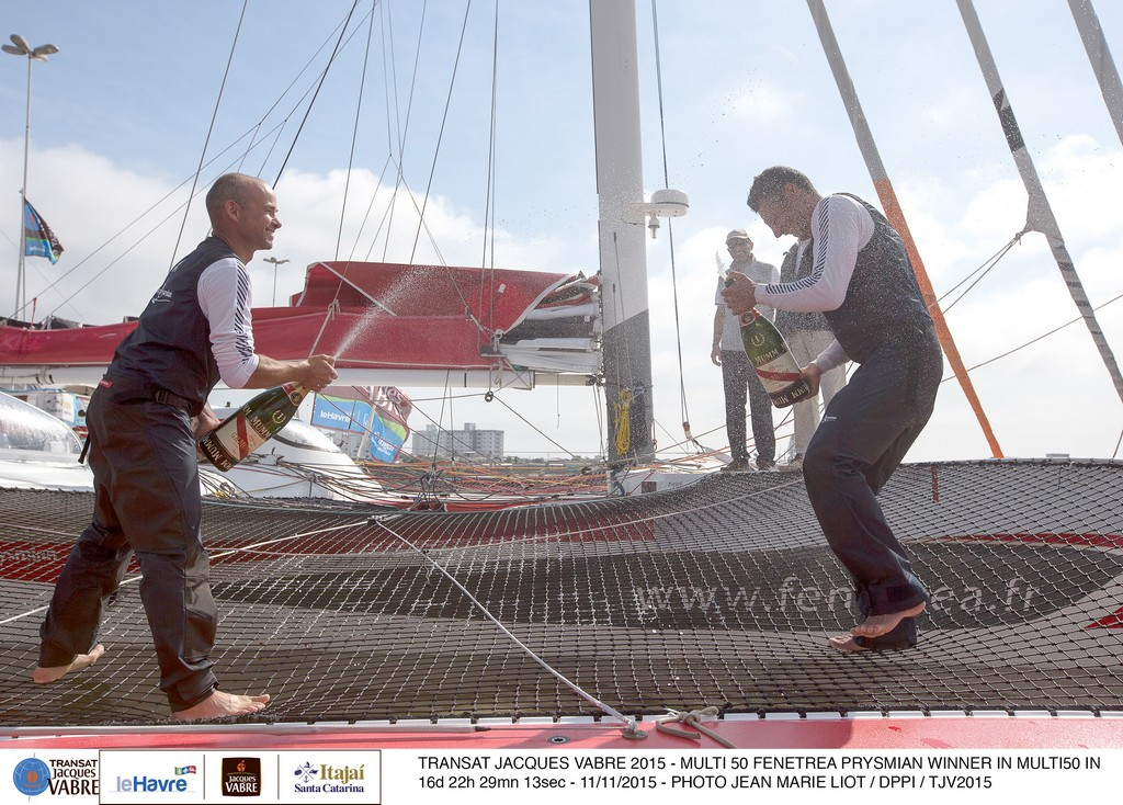 Multi 50 Fenetrea Prysmian, skippers Erwan Le Roux (FRA) and Giancarlo Pedote (ITA), winner in Multi 50 category in 16d 22h 29mn 13sec, celebration with champagne, during the Transat Jacques Vabre sailing race arrivals on november 11, 2015 in Itajai, Brazil - Photo Jean Marie Liot / DPPI