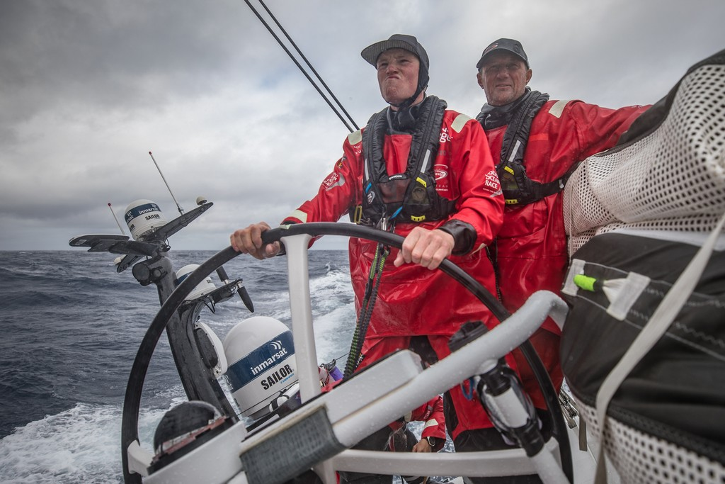 Leg 6 to Auckland, day 05 on board Sun hung Kai/Scallywag. John Fisher coaching Trystan Seal while leaving the helm. 11 February, 2018.