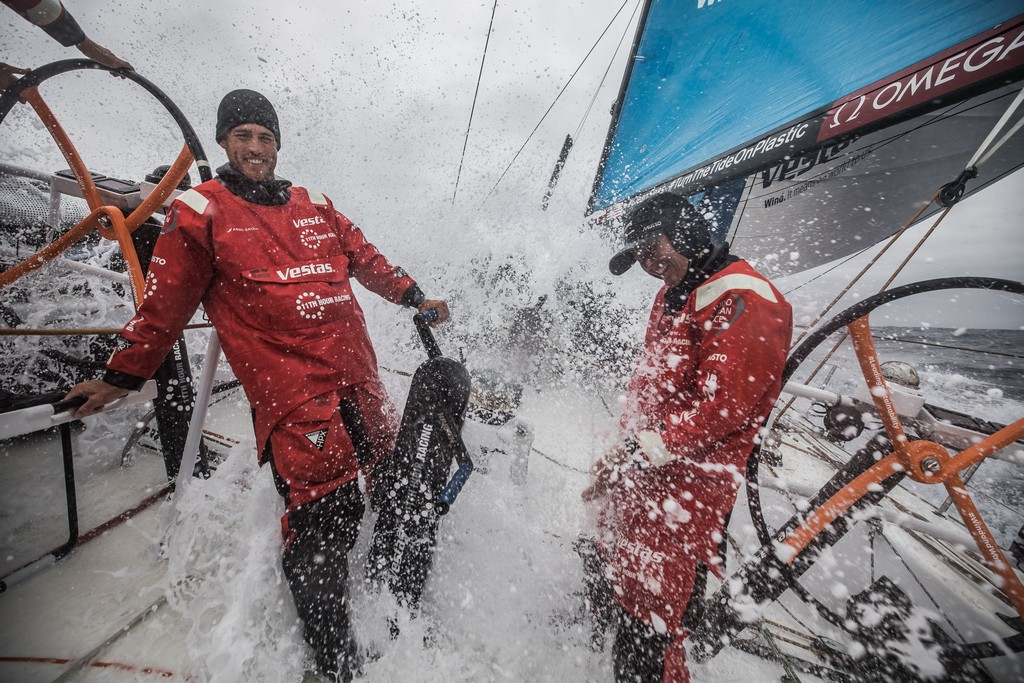Leg 02, Lisbon to Cape Town, day 18, on board Vestas 11th Hour. Photo by Martin Keruzore/Volvo Ocean Race. 22 November, 2017. Nick Dana and Jena Mai Hansen enjoying the bubble party this morning.