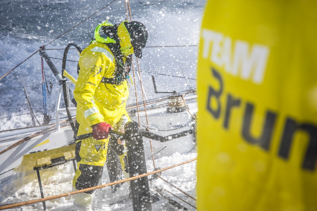 Leg 3, Cape Town to Melbourne, day 13, on board Brunel, Carlo Huisman at th aft pedestal being splashed by a wave. Photo by Ugo Fonolla/Volvo Ocean Race. 21 December, 2017.